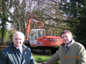 Tom McCully & Michael Dobbins, principals of Belmont House and Foyle View Schools watching work begin on the Playtail